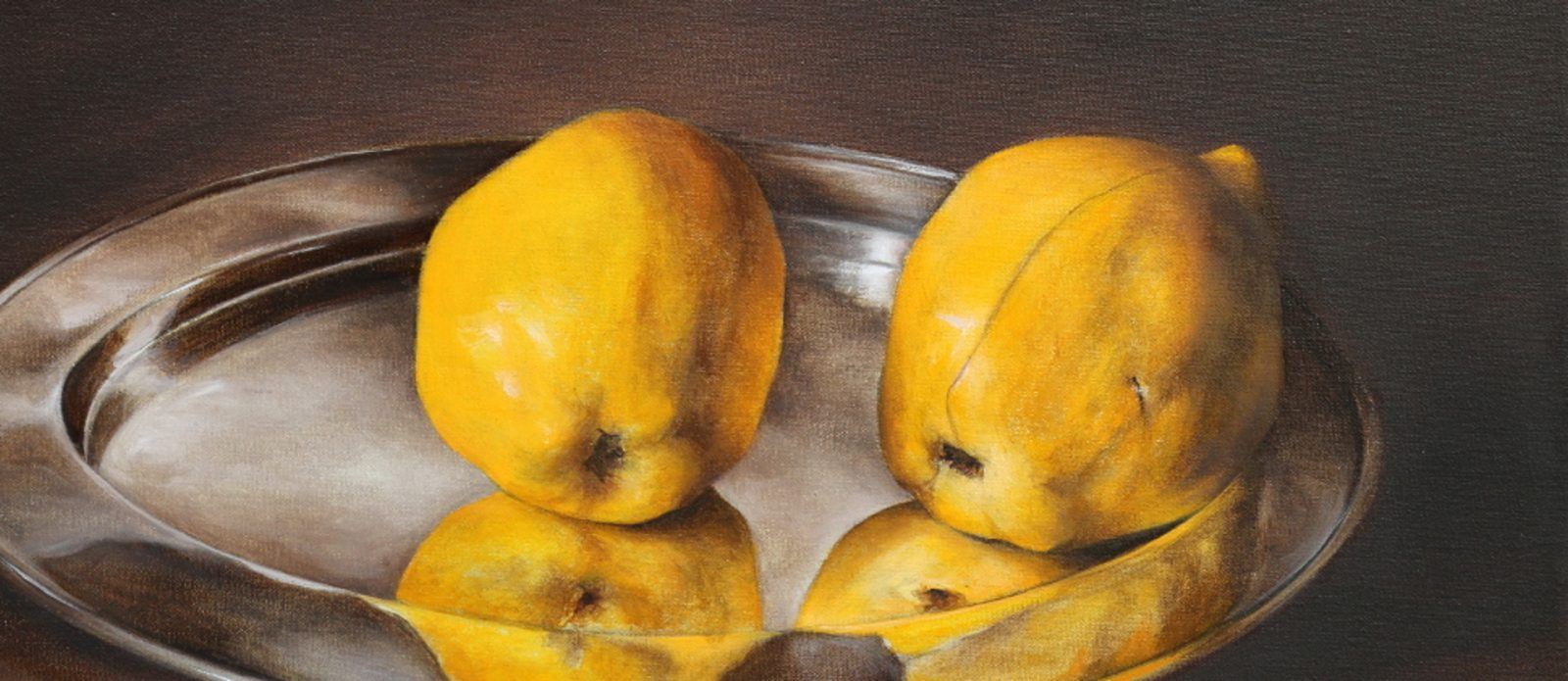 Two quince fruit on a silver platter by Tanja Moderscheim